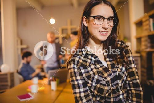 Graphic designer in spectacles at office
