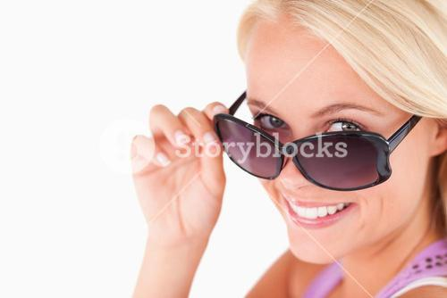 Cute lady peeking over her sunglasses