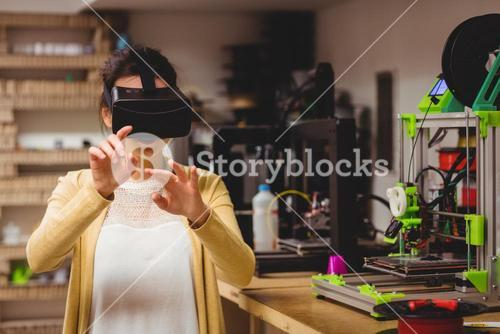 Female graphic designer using the virtual reality headset