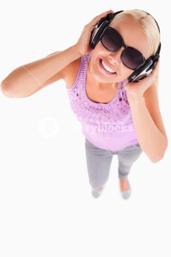 Smiling lady with sunglasses and earphones