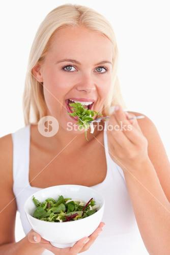 Gorgeous woman eating salad