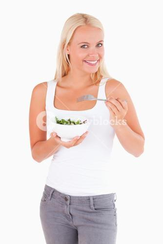 Charming lady eating salad