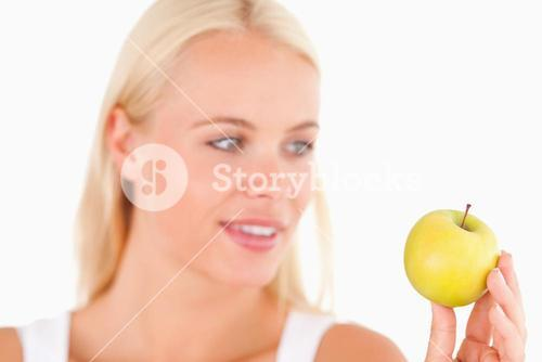 Gorgeous woman holding an apple