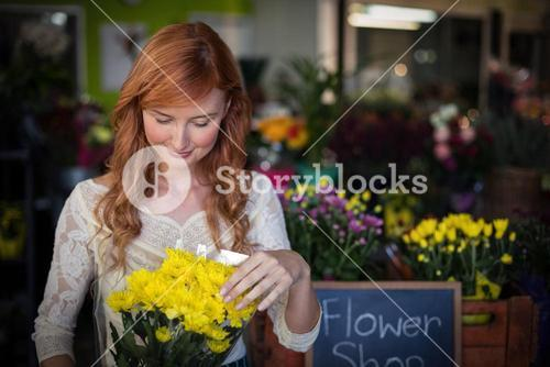 Female florist holding flower bouquet