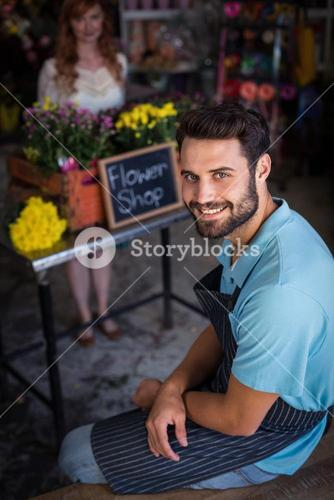 Portrait of male florist sitting and smiling