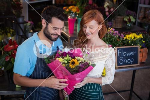 Couple holding flower bouquet