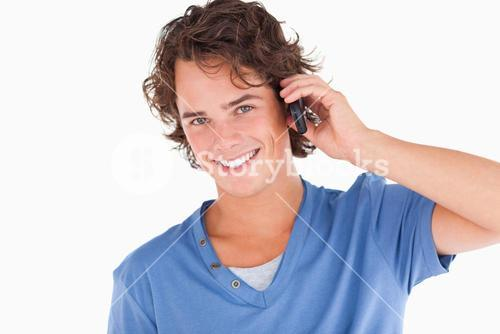 Handsome darkhaired guy on the phone