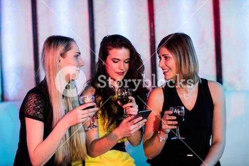 Friends interacting each other while having wine