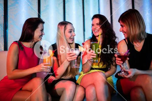 Group of friends sitting together and having mocktail
