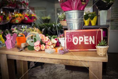 Open signboard on a wooden table