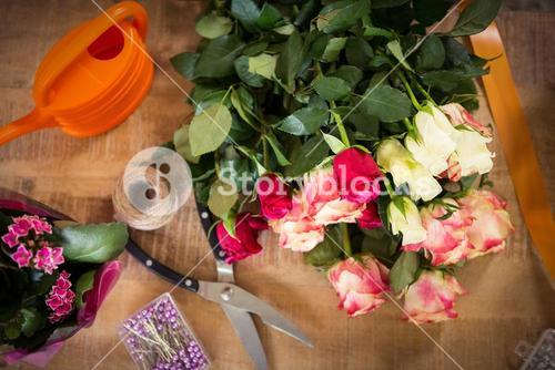 Bouquet of flower material on a wooden worktop