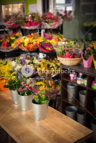 Flower vase arranged on a wooden worktop