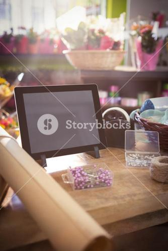 Digital tablet and florist supplies on the wooden table