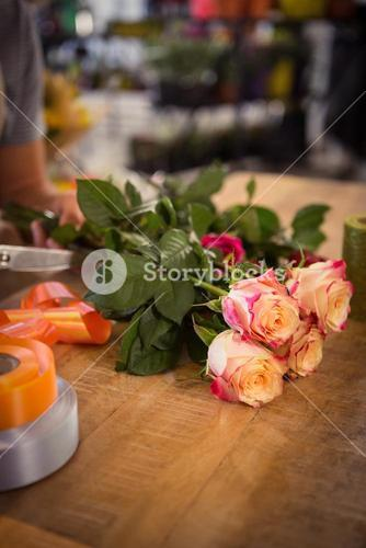 Bunch of pink roses on table