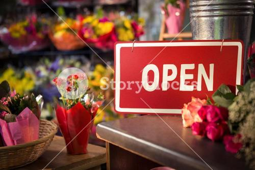 Open signboard on table