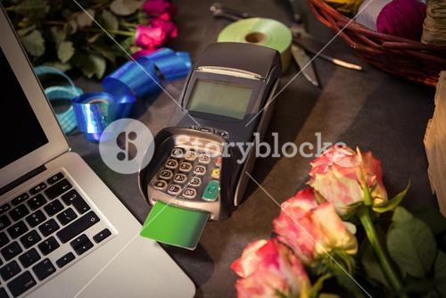 Laptop and credit card terminal on the table