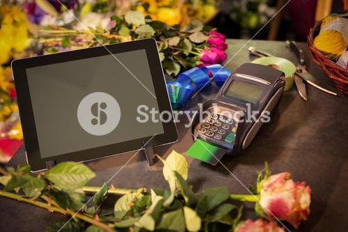 Digital tablet and credit card terminal on the table
