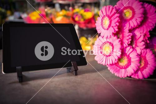 Digital tablet with pink sunflower