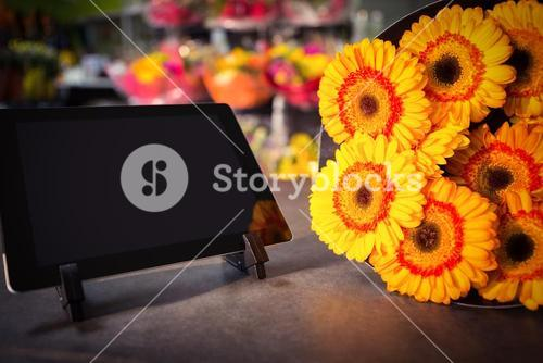 Digital tablet with yellow sunflower