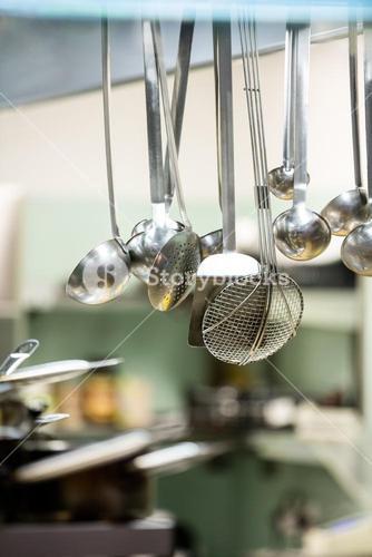 Close-up of hanging kitchen utensils