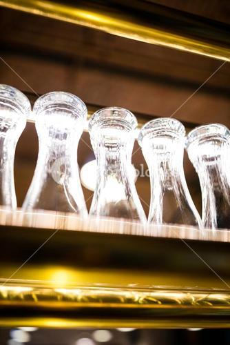 Glasses arranged on the bar shelf