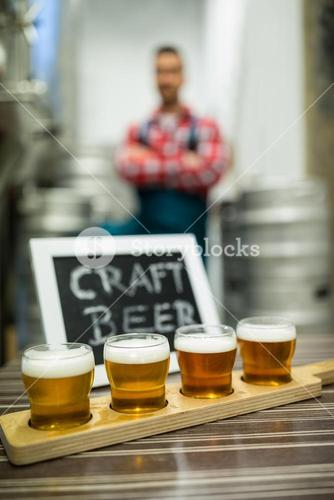Four glasses of craft beer on beer sampler tray