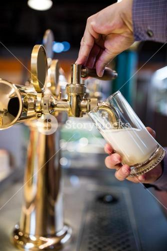 Bar tender pouring beer