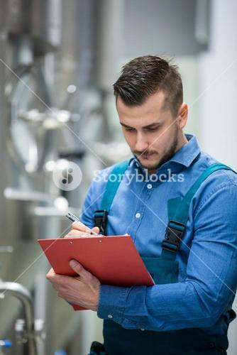 Maintaince worker wrting on clipboard