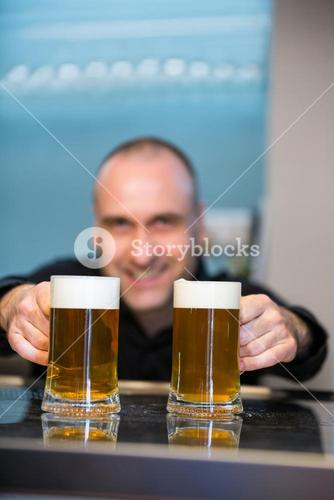Bar tender offering beer