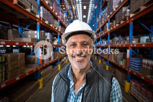 Portrait of happy worker smiling to the camera
