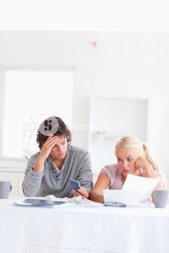 Despaired couple calculating