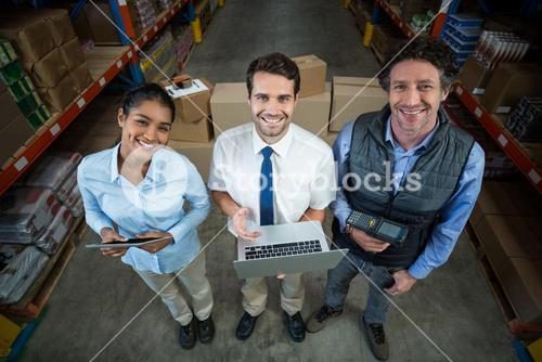 High angle view of managers are smiling and looking the camera