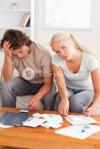 Despaired worn out couple calculating their expenses