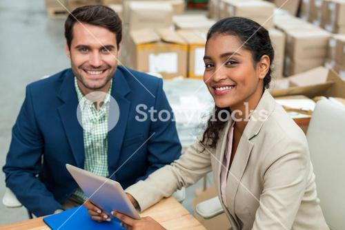 Portrait of happy managers are posing and looking the camera during work