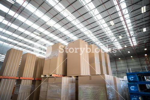 Low angle view of cardboard boxes put on pallets