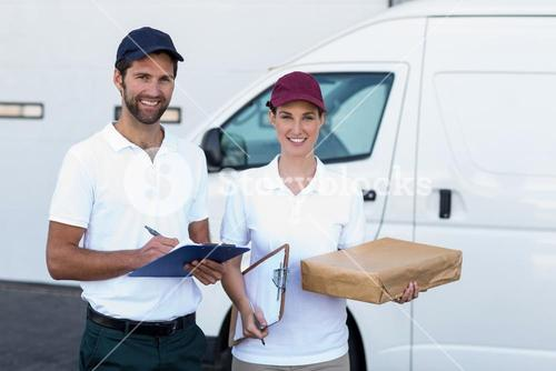 Portrait of delivery people are holding goods and smiling to the camera