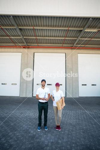 Delivery people are posing and holding goods