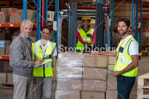 Manager and workers are posing and looking the camera
