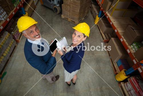 High angle view of managers are wearing hard hat and looking the camera
