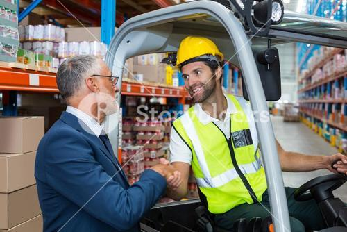 Worker handshaking with well dressed senior person