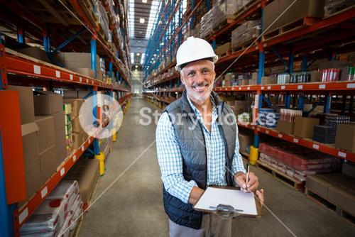 Smiling worker looking at camera