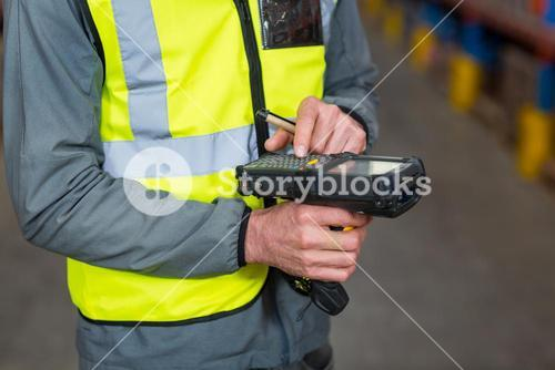 Close-up of worker using digital equipment