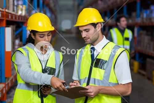 Workers looking at clipboard