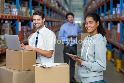 Smiling workers with technology devices