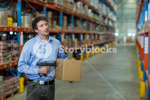 Standing worker holding a box