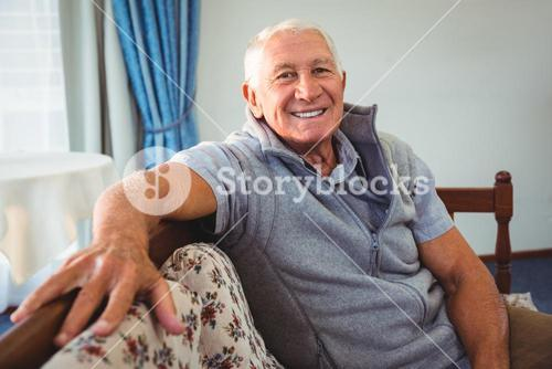 Senior man sitting on a couch
