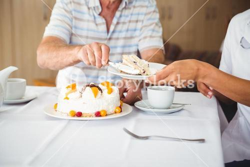 Happy nurse serving a dessert to his patient