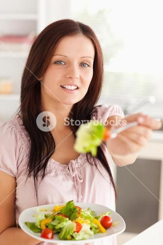 Woman offering salad