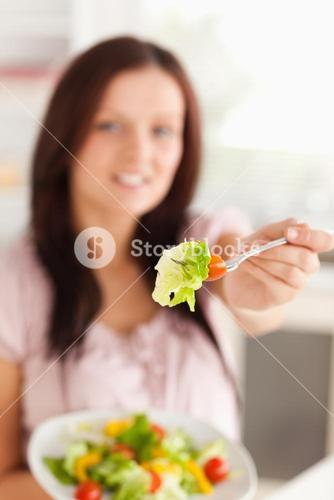 Woman showing salad