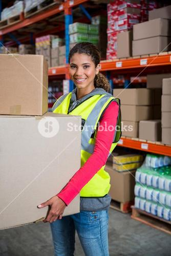 Smiling worker holding boxes
